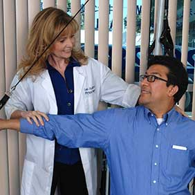 Tami Peavy, Physical Therapist, Practical Therapy4U, instructs client in techniques to relieve back pain. Photo: Angels Touch, Inc.