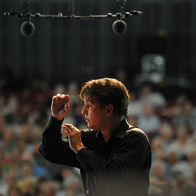 Keith Lockhart, artistic director at Brevard Music Center, conducts during the Brevard Music Festival. Photo: VisitNC.com