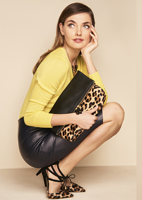 SOUR LEMON MERINO V-NECK SWEATER, ROYAL NAVY LEATHER WRAP PENCIL SKIRT, LEOPARD ERI STRAPPY D'ORSAY FLAT, AND CLASSIC CAMEL SLOUCHY ZIP-FOLD HAIRCALF CLUTCH. PHOTOS: TALBOTS.