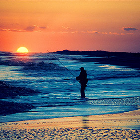 Surf fishing as the sun rises over the Outer Banks. Photo: North Carolina Tourism