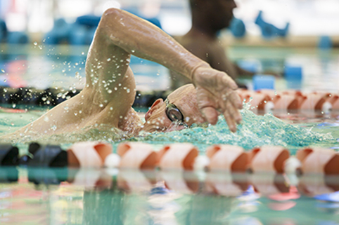 older man swimming healthyaging.net